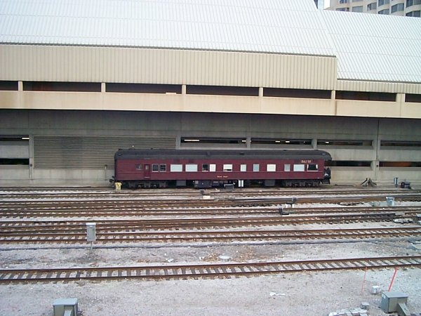 An old St. L & H train car, sitting on a tail track just outside of Union Station, Toronto.